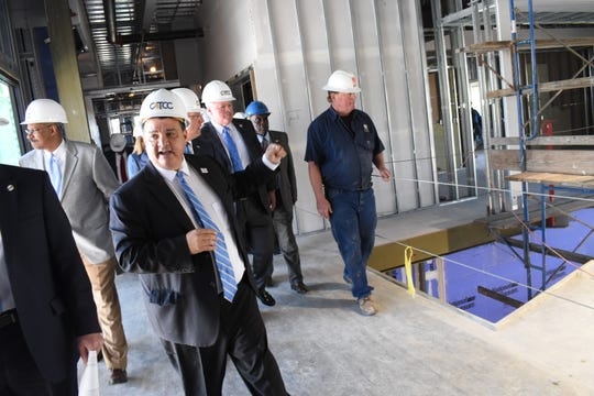 Gov. John Bel Edwards tours the new construction of the Central Louisiana Technical Community College in downtown Alexandria on Tuesday, March 26, 2019. Jimmy Sawtelle, chancellor of CLTCC, guided Edwards and other dignitaries on the tour of the new downtown buildings.