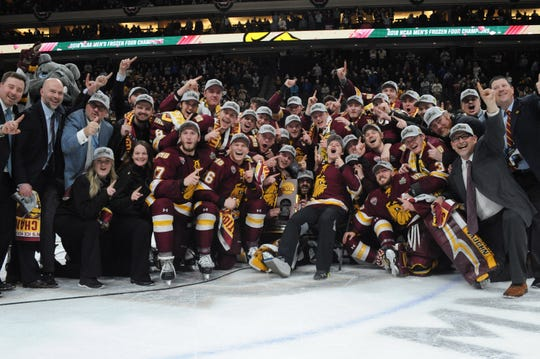 Minnesota Duluth Bulldogs pose with the NCAA championship trophy celebrating the 2-1 win over Notre Dame in the 2018 Frozen Four college hockey national championship game at Xcel Energy Center.