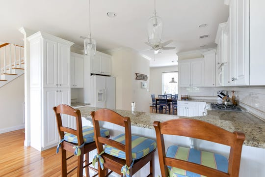 The kitchen features a breakfast nook with granite stone counter tops.