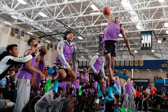 Mar 25, 2019; Marietta, GA, USA; McDonalds High School All American forward Scottie Lewis dunks during the Powerade Jamfest dunk competition at Wheeler High School. Mandatory Credit: Brian Spurlock-USA TODAY Sports