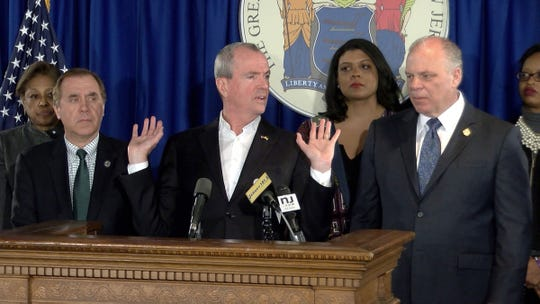 NJ Governor Phil Murphy holds a press conference along with Assembly Speaker Craig J. Coughlin (left) and Senate President Stephen M. Sweeney in Trenton, NJ, Monday, March 25, 2019.  Earlier, Legislators had decided to hold back bills that would legalize recreational marijuana sales.