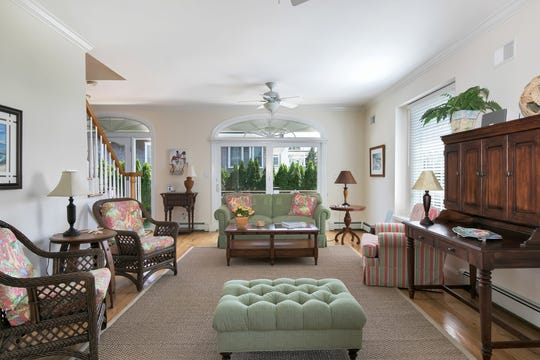 The family room has an open floor plan and set of French doors.