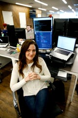 Brittany Jacobs is shown at her computer inside Vydia at Bell Works in Holmdel Tuesday, March 26, 2019.  She is one of the shore entrepreneurs who are trying to connect with underprivileged students, encouraging them to go into the technology field.