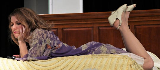 """Maggie (Andrea Robison) muses about unfilled life in this rehearsal scene from Abilene Community Theatre's """"Cat on a Hot Tin Roof."""""""