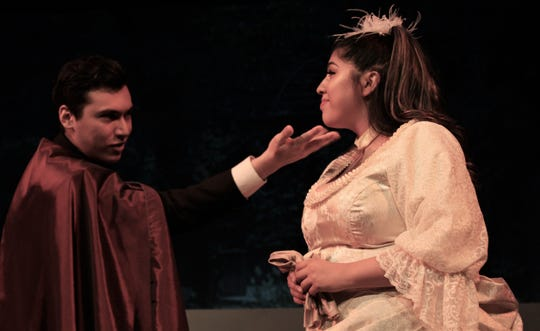 "Hanna Glawari (Janet Moreno) is wooed in song by Count Danilo Danilovitch (Aaron Dominguez) in this rehearsal scene in Hardin-Simmons University's production of ""The Merry Widow."" Moreno is in the title role Friday night."