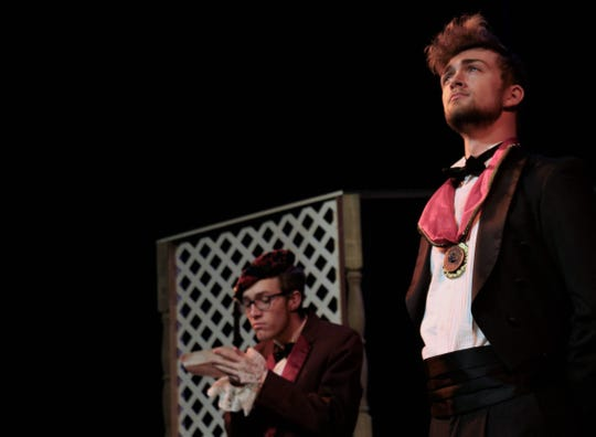 "Baron Mirko Zeta (Chasen Watson, right) listens as Njegus (Ben Burke) reads correspondence in this rehearsal scene in Hardin-Simmons University's production of ""The Merry Widow."""