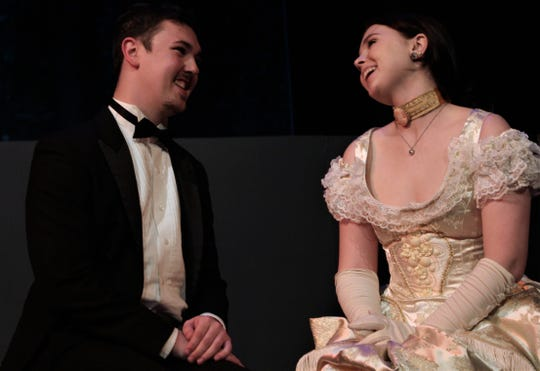 "Valencienne (Shelby Walker) laughs with Camille de Rosillon (Bryson Rule) seated on a bench in this rehearsal scene in Hardin-Simmons University's production of ""The Merry Widow."" Rule is de Rosillon in Friday's performance."