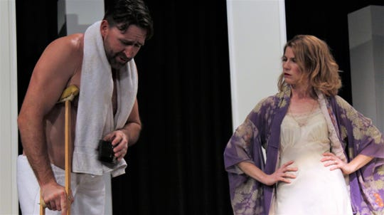 """Brick (Nicolas Gooch) and Maggie (Andrea Robison) square off after Brick is injured trying to relive his past athletic glory days in this rehearsal scene from Abilene Community Theatre's """"Cat on a Hot Tin Roof."""""""