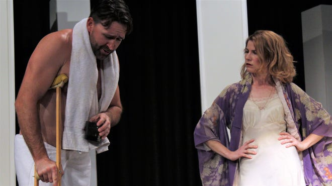 "Brick (Nicolas Gooch) and Maggie (Andrea Robison) square off after Brick is injured trying to relive his past athletic glory days in this rehearsal scene from Abilene Community Theatre's ""Cat on a Hot Tin Roof."""