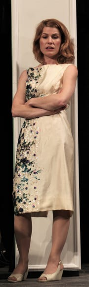 """Maggie (Andrea Robison) strikes a pose in this rehearsal scene from Abilene Community Theatre's """"Cat on a Hot Tin Roof."""""""