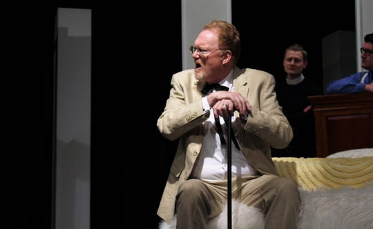 """Big Daddy (Scot Miller) fires back at his son Brick in this rehearsal scene from Abilene Community Theatre's """"Cat on a Hot Tin Roof."""""""