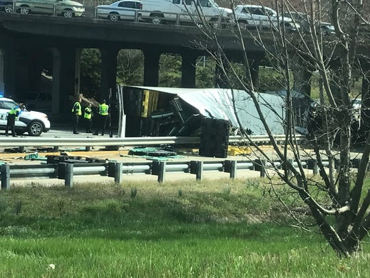 A tractor-trailer flipped Tuesday afternoon in Jackson's Curve on an I-240 eastbound ramp, snarling traffic downtown.