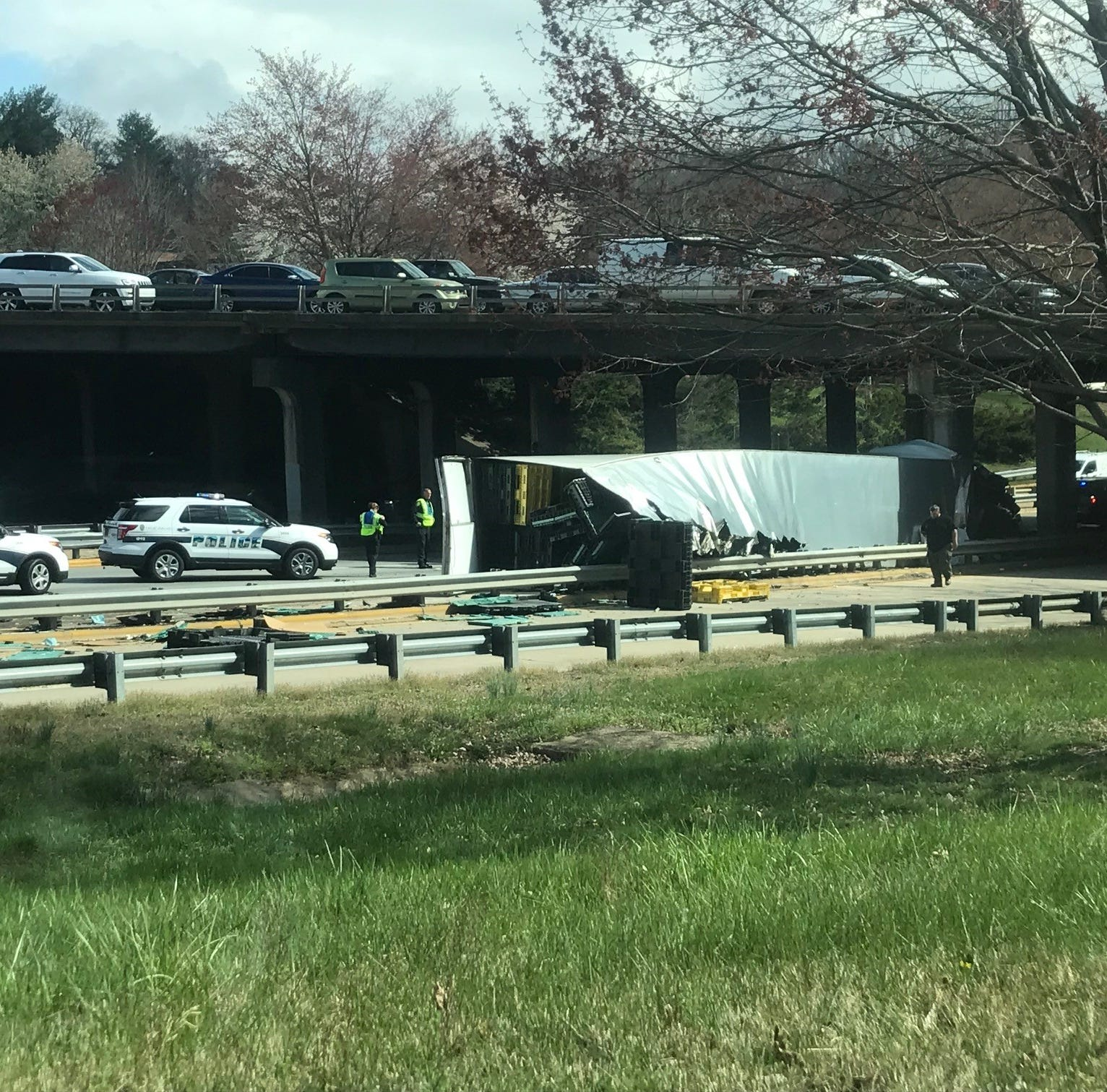 A tractor-trailer flipped over at about 3:15 p.m. Tuesday on Jackson's Curve on I-240 eastbound, snarling traffic on the Bowen Bridge and in downtown.