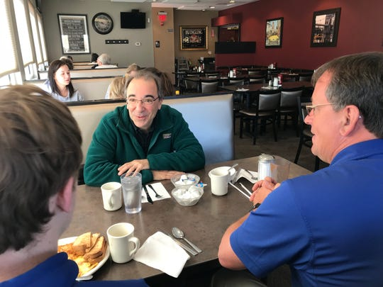 Retired Maine-Endwell High School teacher John Perricone, center, chats with former students Jamie Hess (Class of 1987) and Jamie Hess Jr. (Class of 2014) at the Broadway Diner in Endwell.