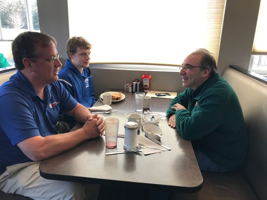 Retired Maine-Endwell High School teacher John Perricone, right, chats with former students Jamie Hess (Class of 1987) and Jamie Hess Jr. (Class of 2014) at the Broadway Diner in Endwell.