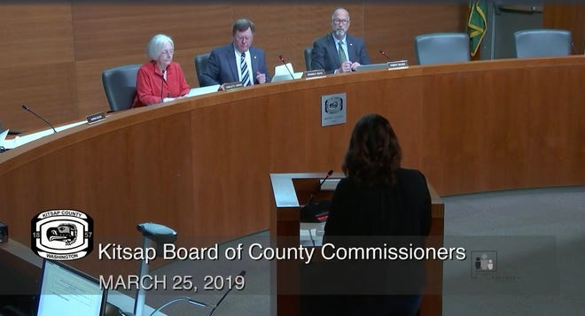 Kitsap County commissioners look on during a public hearing on March 25, 2019.