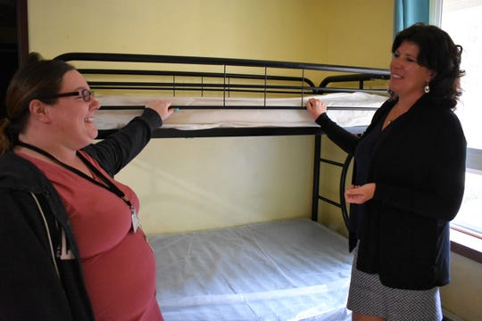 From left, Turning Pointe Survivor Advocacy Center client advocate Tammy Bacigalupo and executive director Gina Blanchard-Reed discuss programming at the shelter in Shelton. The nonprofit has expanded programming in Belfair in the wake of two domestic violence incidents in the area last year.