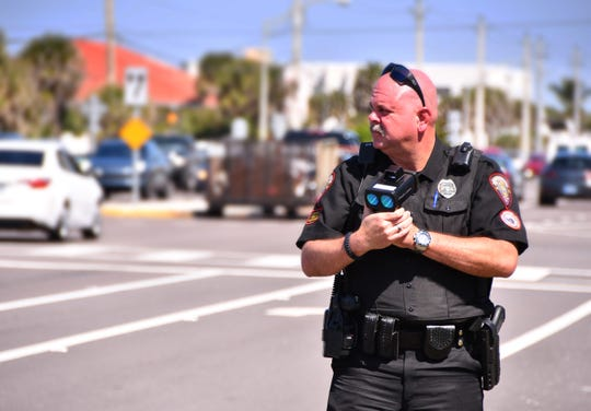 Melbourne Police Officer Mark Whitright with the selective traffic enforcement unit by Canova Beach Park with a Laser, used to check speed. He was just noth of the where the fatal pedestrian accident happened Saturday night.