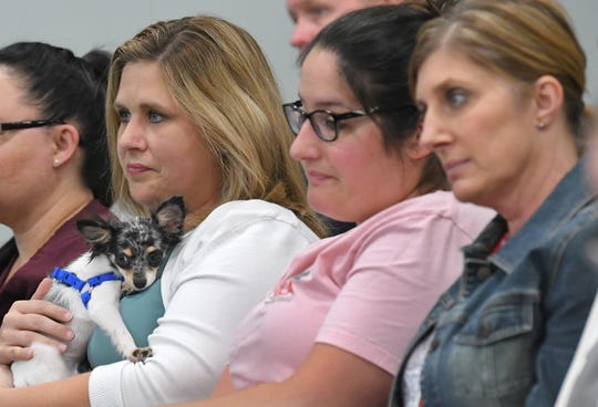 Staff members from the SPCA of Brevard Adoption Center in Titusville attended in support of better regulate the sale of cats and dogs in Brevard pet stores proposed by Vice Chair Bryan Lober at the Brevard County Commission meeting.