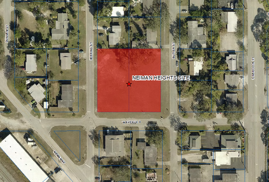 Shown here is a piece of unused land owned by the school district, labeled Neiman Heights. It is 1 acre and valued at $90,000.