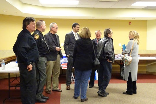 Candidates greet people attending a candidates night at the Bucyrus Public Library on Monday before the event started. From left are Mike Allonas, Sheriff Scott Kent, Dan Wirebaugh,  Kurt Fankhouser, Louis Katona III, Ronal Bores and a woman attending the event.