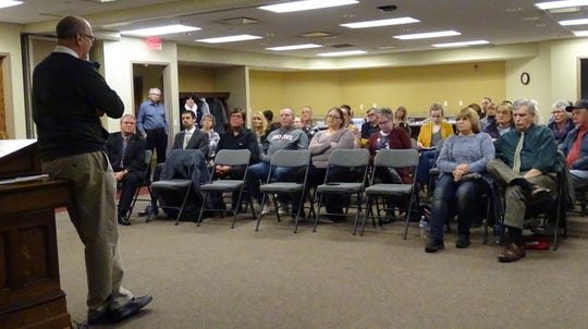 The audience listens as Jeff Reser, seeking reelection as mayor of Bucyrus, speaks during a candidates night Monday at the Bucyrus Public Library.
