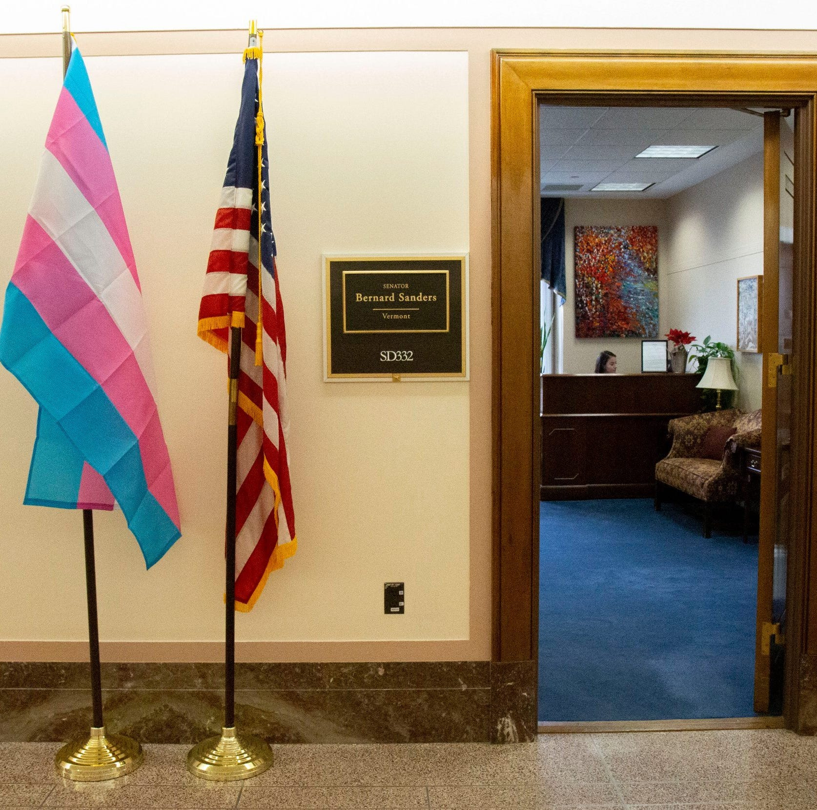 Sen. Bernie Sanders hangs transgender pride flag outside his office