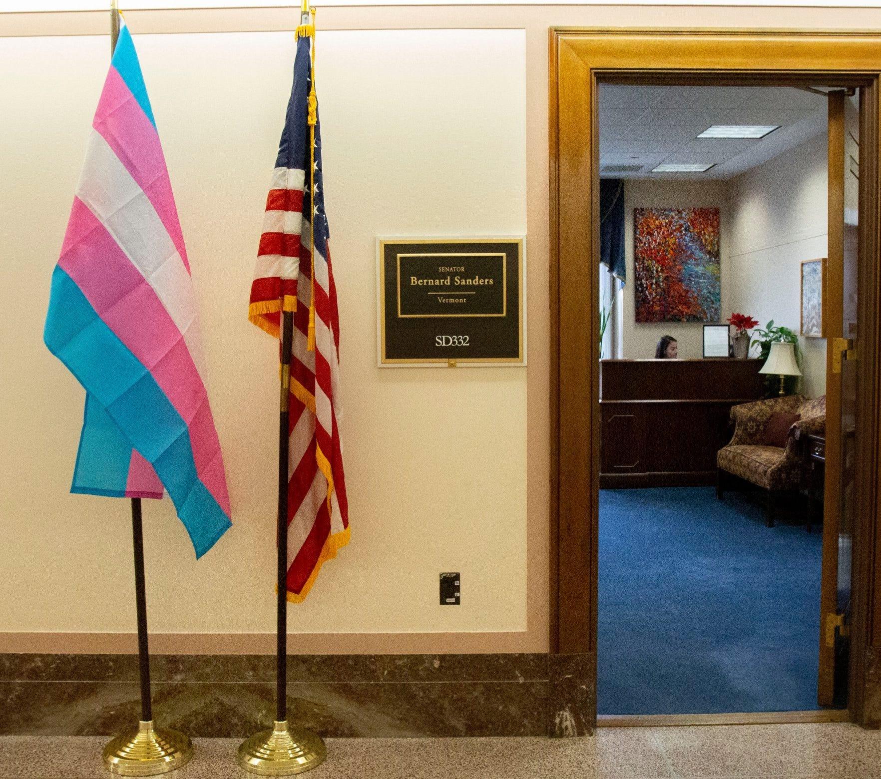 Image of a transgender pride flag hanging outside Sen. Bernie Sander's Washington, D.C. office.