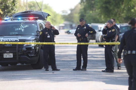 Corpus Christi Police Chief Mike Markle talks on his cellphone next to Deputy Chiefs Mark Guiterrez and Billy Breedlove in the 200 block of Torreon Street on Tuesday, March 26, 2019.