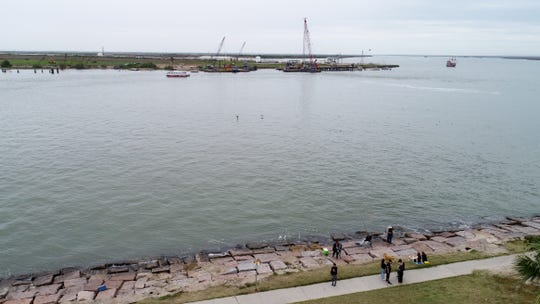 People fish from Roberts Point Park in Port Aransas across the ship channel from Harbor Island on Wednesday, March 21, 2019. The Port of Corpus Christi has proposed a multi-billion dollar project for an oil terminal on Harbor Island.