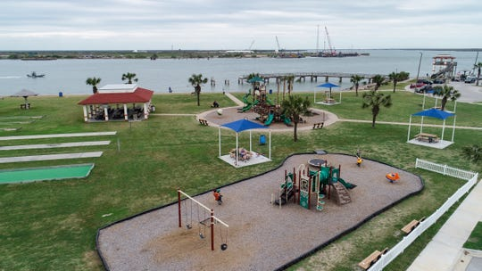 Kid play at Roberts Point Park in Port Aransas across the ship channel from Harbor Island on Wednesday, March 21, 2019. The Port of Corpus Christi has proposed a multi-billion dollar project for an oil terminal on Harbor Island.