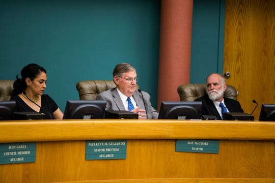 City council members Paulette Guajardo (left) and Greg Smith (right) listen as Mayor Joe McComb (center) gives a statement regarding the proposed annexation by Corpus Christi of San Patricio County land prior to the start of public comment on Tuesday, March 26, 2019 at city council.