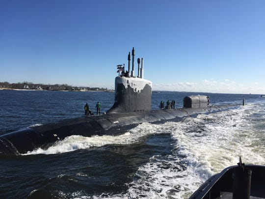 The Virginia-class attack submarine USS North Dakota (SSN 784) transits the Thames River as it pulls into its  homeport at Naval Submarine Base New London in Groton, Conn. A sister vessel, the submarine USS New Jersey, SSN-796, is under construction in Virginia,  (U.S. Navy photo by Cmdr. Jason M.