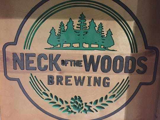 Neck of the Woods Brewing Company logo.