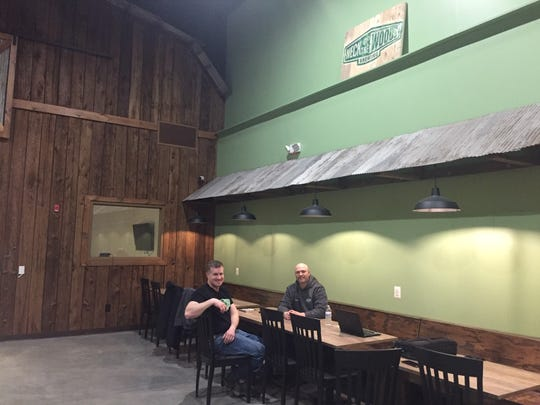 Neck of the Woods co-owners Paul McIntyre (left) and Dave Surdam relax in the Mantua tasting room. The owners (who also include Frank Price and Bruce Lowden) hope to open the brewery doors by early May.