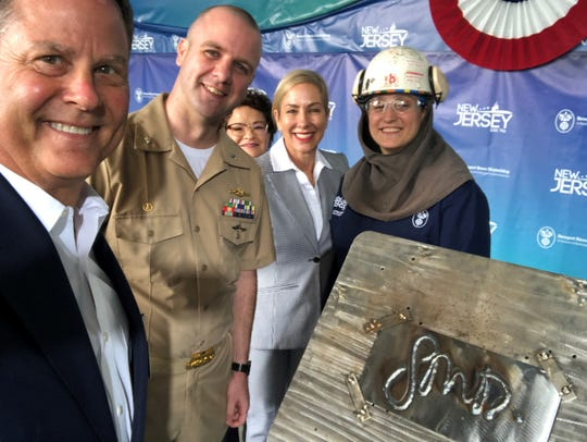 Congressman Donald Norcross (far left)  at Newport News Shipbuilding for the engraving this week of the keel plate for the latest USS New Jersey, a fast attack Navy submarine under construction there. Also shown (from left) are the sub's commanding officer, Cmdr. Joseph Spinks, ship sponsor Dr. Susan DiMarco of Montclair and the plate welder,    Jessica Batruk of Monmouth County.