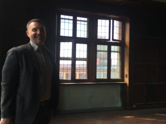 Joe Balzano Jr. shows a 7th floor office, complete with its original woodwork, at the Victor Talking Machine Company Building. Balzano's company, EMR, purchased the historic building for its U.S. headquarters.