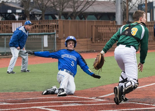 Aaron Gillum slides into home to score for Southeastern Monday night at the VA Memorial Stadium. The Panthers lost to North Adams 8-6.