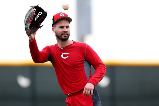 Cincinnati Reds right fielder Jesse Winker (33) catches a ball during drills, Wednesday, Feb. 13, 2019, at the Cincinnati Reds spring training facility in Goodyear, Arizona.