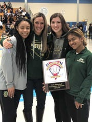 JP Stevens girls basketball coach with players (from left to right) Kayla Gatling, Megan Duffy and Disha Prabhudesai.