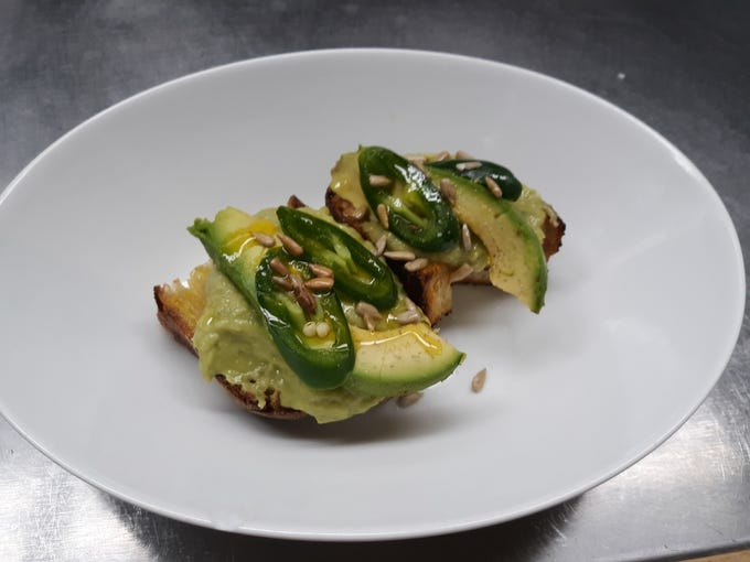 The upscale 'Avocado Toast' appetizer is a perennial favorite at The Martinsville Tavern in Martinsville.
