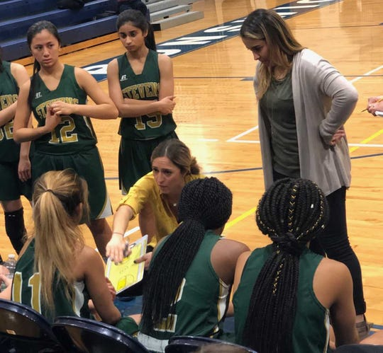 JP Stevens girls basketball coach Amy Field speaks to her team during a game.