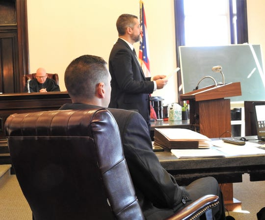 Coshocton County Prosecutor Jason Given makes opening statements to a jury during the trial of Chase Heath on Tuesday in Coshocton County Common Pleas Court. Looking on are Judge Robert Batchelor and Assistant Prosecutor Ben Hall.