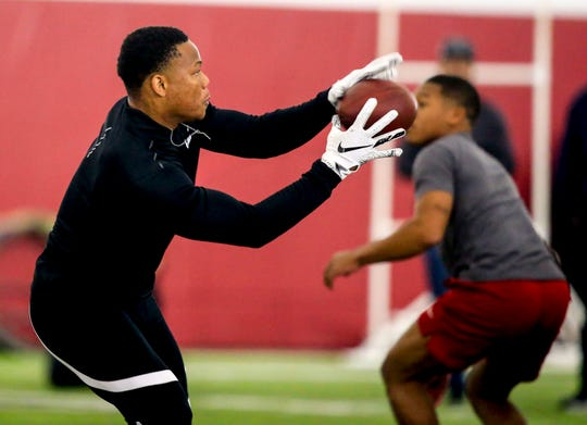 Iowa State running back David Montgomery runs drills for NFL scouts during Iowa State's Pro Day at Bergstrom Football Complex in Ames Tuesday, March 26, 2019.