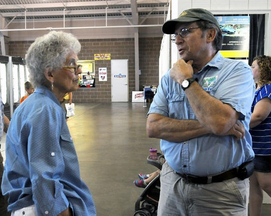 Journalist Chuck Offenburger of Cooper, right, visits with longtime Iowa State Fair food superintendent Arlette Hollister of Des Moines.