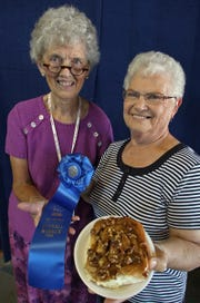 The Tones Cinnamon Roll  contest is one of the most popular and prestigious. Arlette Hollister, (left), State Fair food superintendent is shown with past  winner Janice Nostrom.