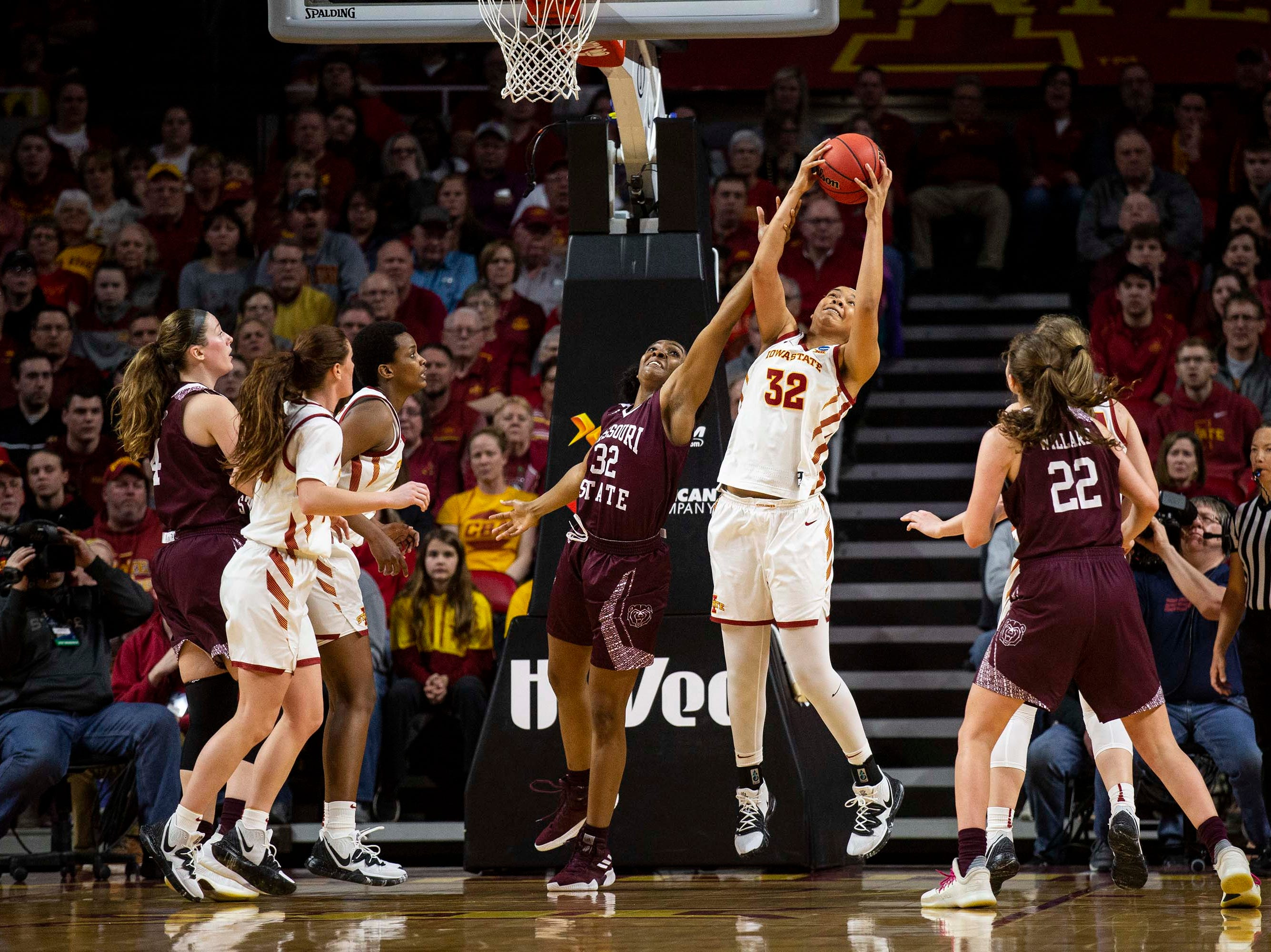 Missouri State's Jasmine Franklin and Iowa State's Meredith Burkhall reach for a rebound during the NCAA Tournament second-round match-up between Iowa State and Missouri State on Monday, March 25, 2019, in Hilton Coliseum, in Ames, Iowa.