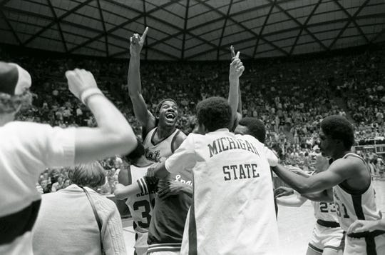 Michigan State's Earvin (Magic) Johnson raises his finger to indicate the Spartans are number one after defeating Larry Bird's Indiana State team 75-64 to win the NCAA Championship in Salt Lake City, March 26, 1979.