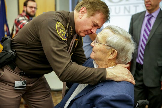 Oakland County Sheriff Mike Bouchard embraces Oakland County Executive L. Brooks Patterson after Patterson  made an announcement that he has Stage 4 pancreatic cancer during a press conference at his office in Waterford, Mich. on Tuesday, March 26, 2019.