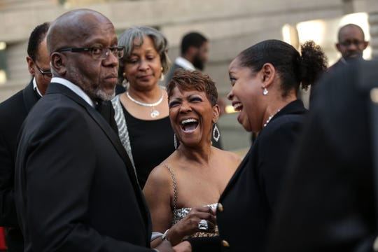 "Sabrina Owens (center), niece of Aretha Franklin, laughs with other guests during the ""Amazing Grace"" reception at the Charles H. Wright Museum in Detroit on Monday, March 25, 2019."